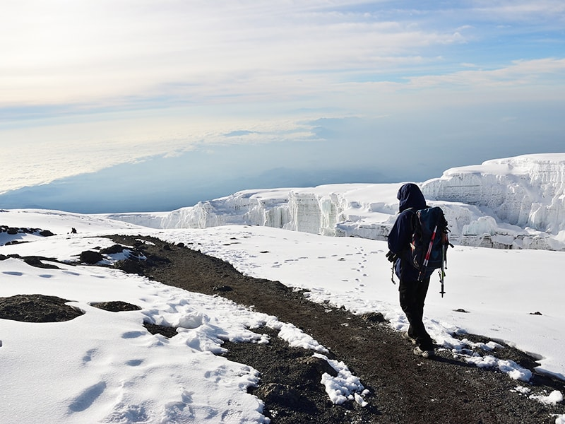 Tanzania. Hike up the snowy peaks of Mount Kilimanjaro