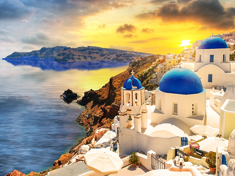 Greece. Witness the magical sunsets of Santorini