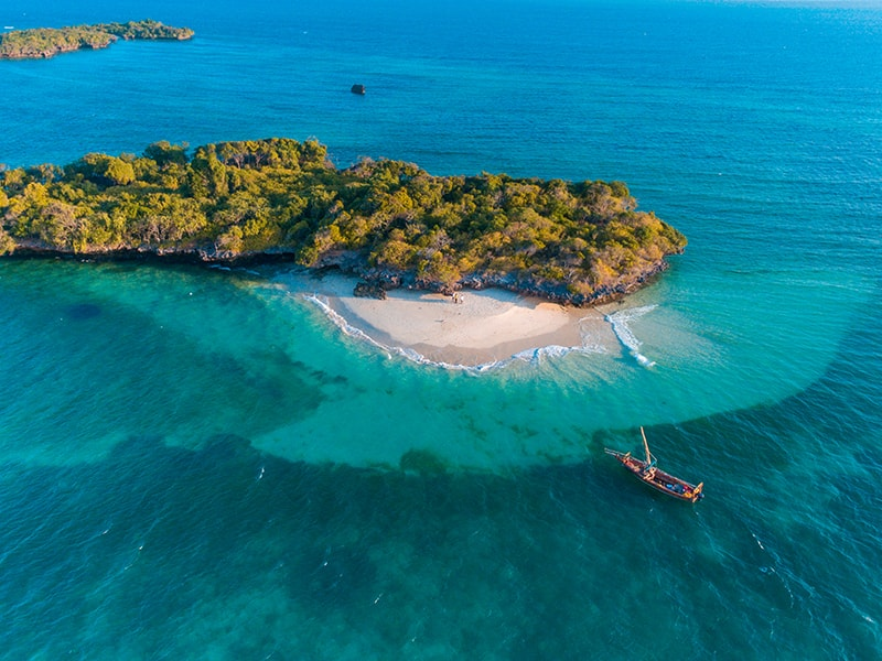 Beaches of Africa. Relax in a traditional Zanzibar dhow boat