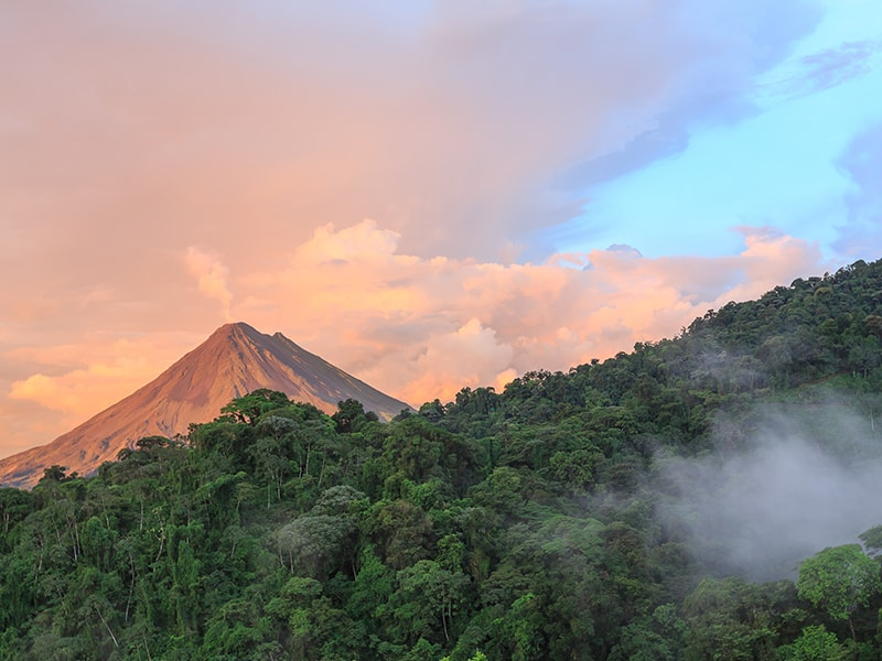 Costa Rica. Caress the tops of the trees by gliding through the canopy of the rainforest in Arenal